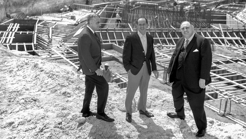 Project manager Jerry Wald, from left, hotel President Nate Jacobson and Caesars founder Jay Sarno stand on April 9, 1965, beside the concrete and timbers that would become the legendary Caesars Palace.