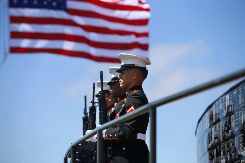 Members of the Marine Corps Recruit Depot Military Funeral Honors detail stand at attention.