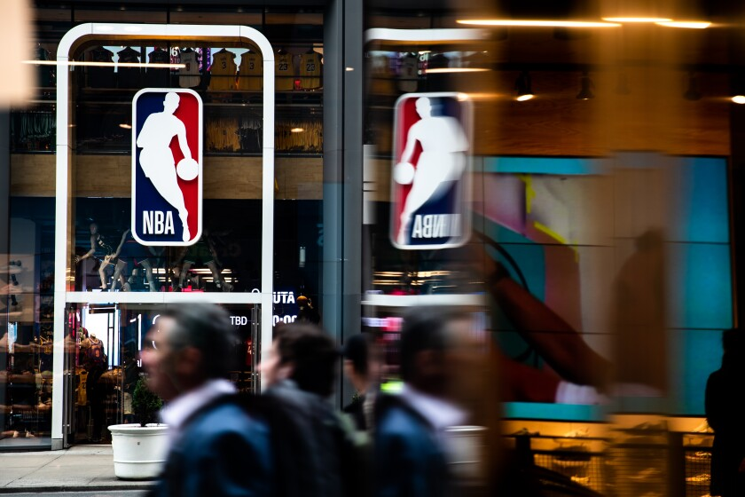 The NBA, which suspended the season in mid-March, says teams can resume practicing on May 8, but with restrictions.
