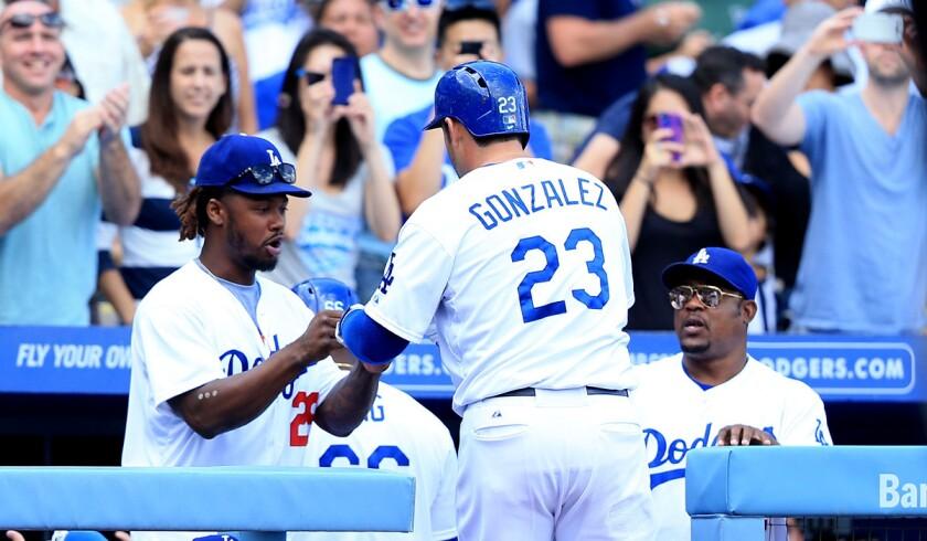 The Dodgers have veteran infielders Hanley Ramirez, left, Adrian Gonzalez and Juan Uribe to help anchor a talented starting lineup.