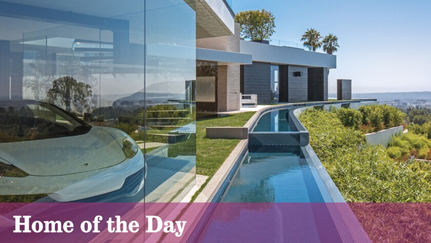 An all-glass garage overlooks a moat-style water feature at this $42-million Beverly Hills home.