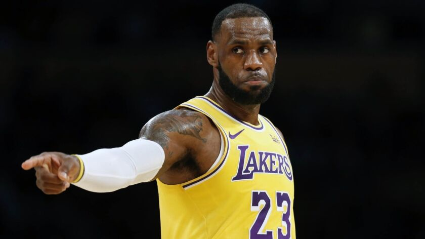 Lakers forward LeBron James plays in a preseason game against Denver on Oct. 2.