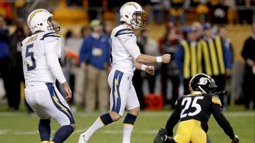 Los Angeles Chargers holder Donnie Jones (5) watches as the field goal by kicker Mike Badgley (4) is