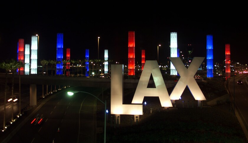 A person who works as a medical screener at LAX has tested positive for the new coronavirus.