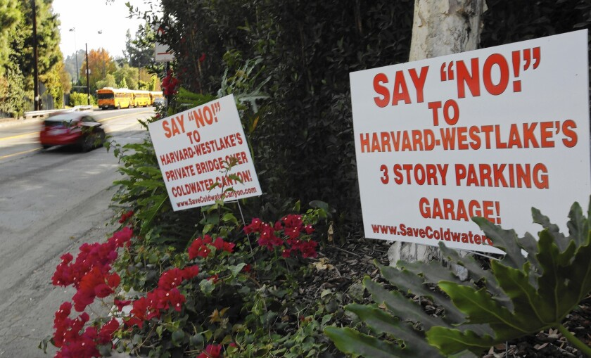 Signs opposing Harvard-Westlake School's proposed 750-space parking structure are posted along Coldwater Canyon Avenue in Studio City.