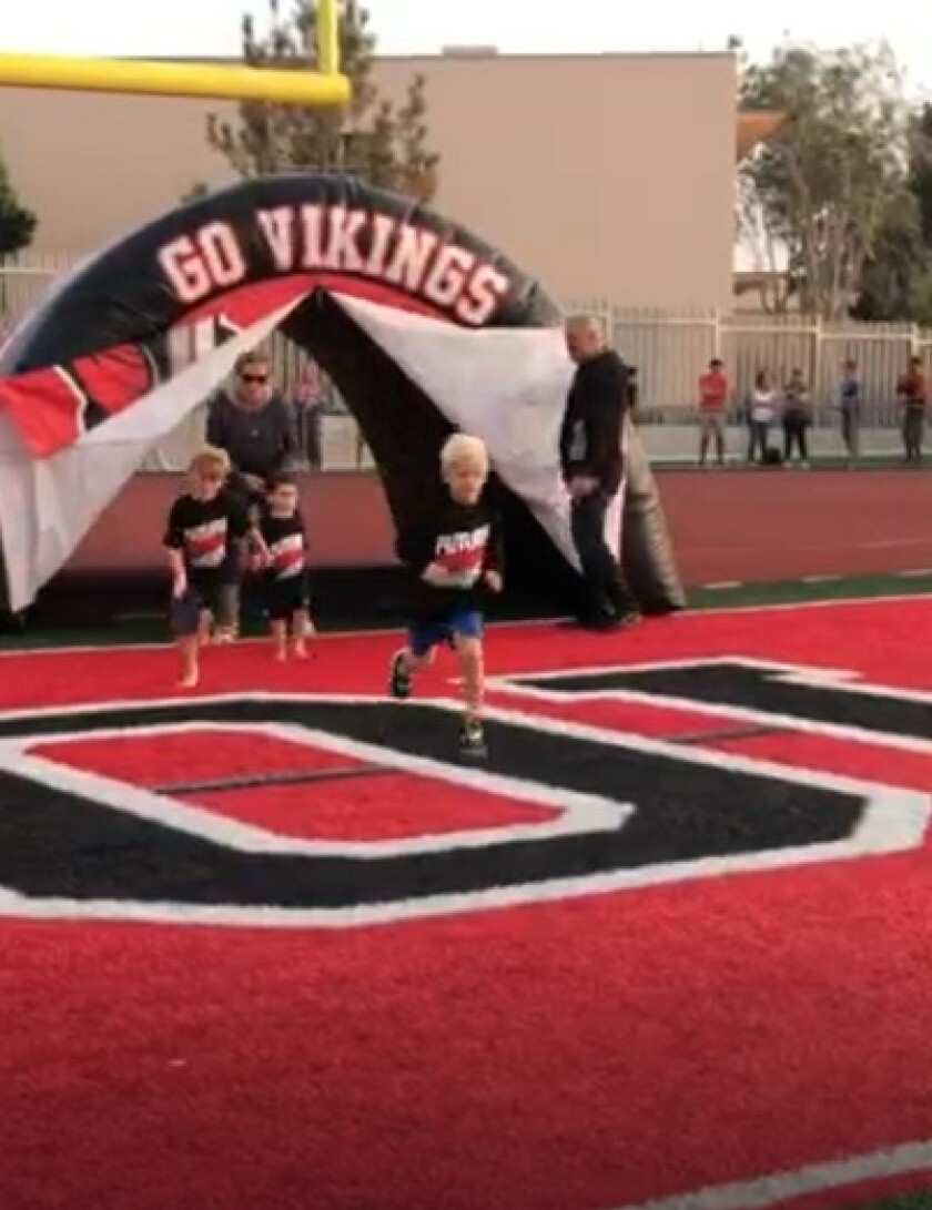 "Runners who opt for the ""photo finish"" in the Viking 5K Charge can run through the tunnel that is used at football games."