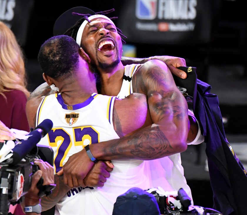 Lakers LeBron James and Dwight Howard embrace after their championship win.