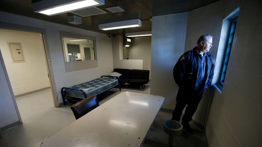 A Beverly Hills Police jail supervisor looks out the window of the women's pay to stay jail cell dorm on Jan. 17.