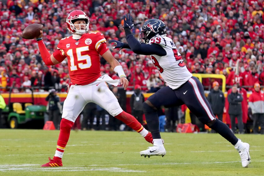 Kansas City Chiefs quarterback Patrick Mahomes scrambles under pressure from Houston's Whitney Mercilus during an AFC playoff game Jan. 12 at Arrowhead Stadium.