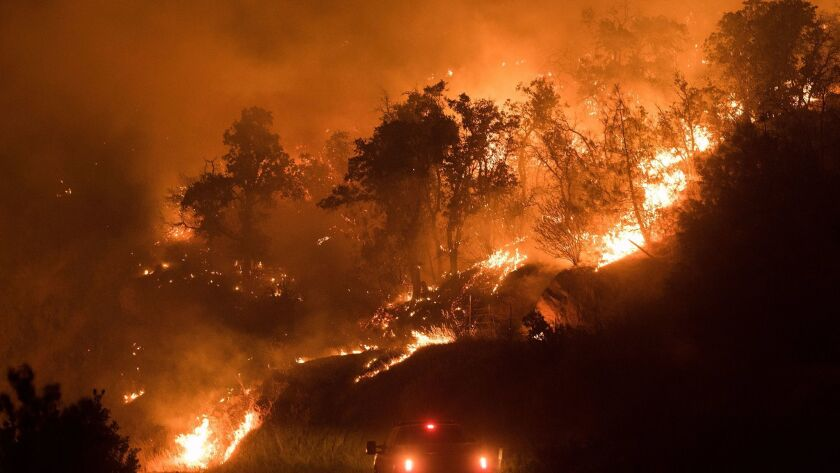 Flames from the Detwiller fire spread down a hillside near Mariposa, California on July 17, 2017.