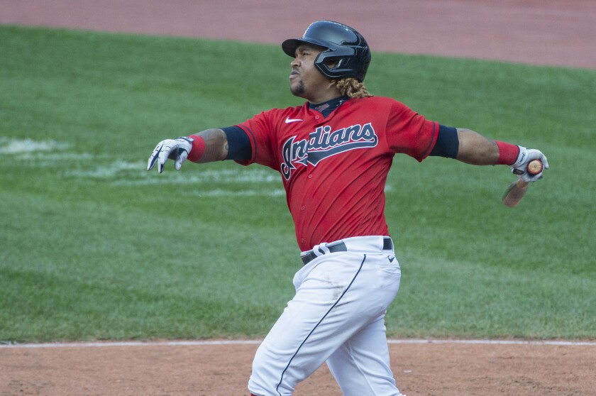 Cleveland Indians' Jose Ramirez watches his double off Pittsburgh Pirates relief pitcher Nik Turley during the seventh inning of a baseball game in Cleveland, Sunday, Sept. 27, 2020. (AP Photo/Phil Long)