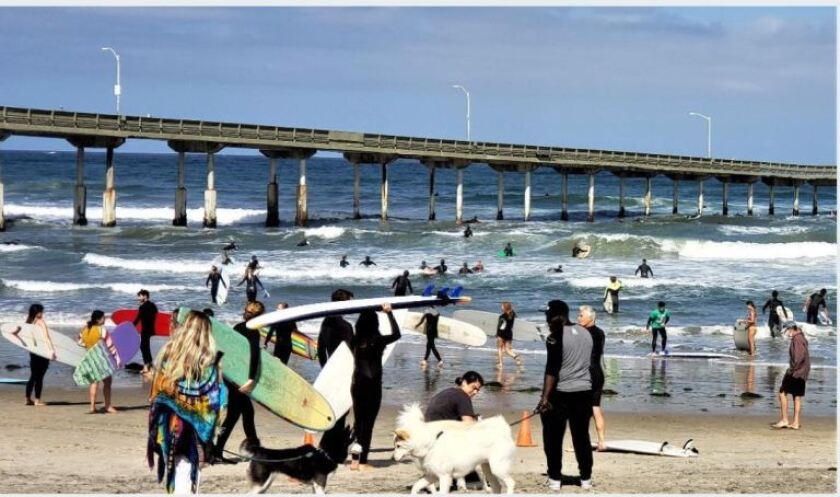 Surfers hit the waves in Ocean Beach on June 7 during a paddle-out in support of the Black Lives Matter movement.