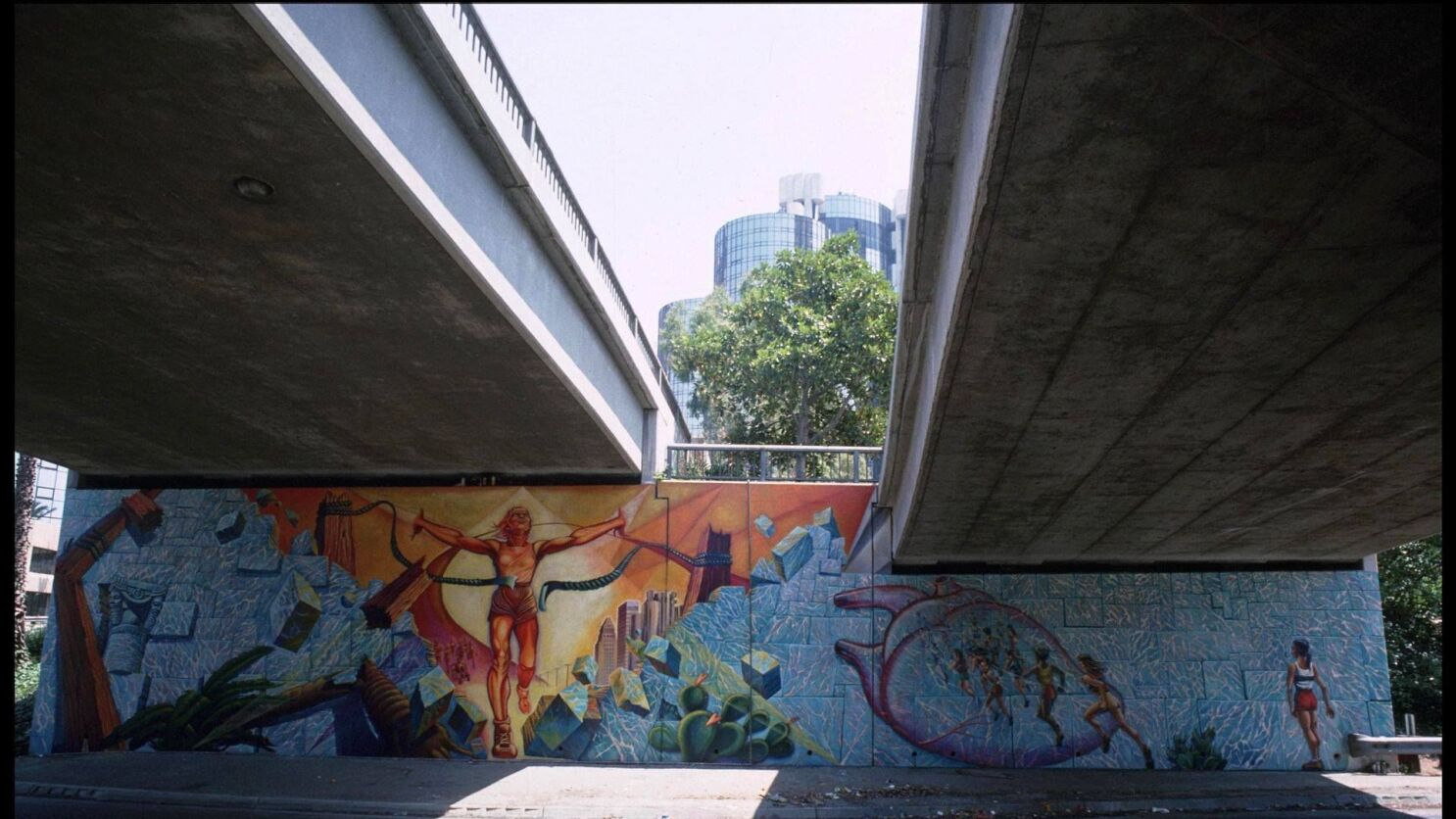 Artist is 'heartbroken' after iconic L A  mural gets whitewashed