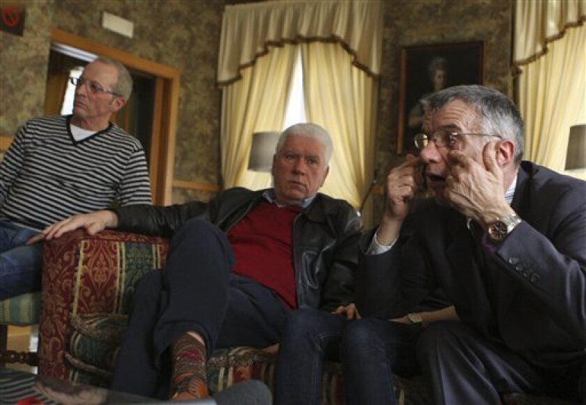 From left Gianni Bisoli, 60, Dario Laiti, 59, and Alessandro Vantini, 60, attend an interview with Associated Press in a hotel in Rome, Friday, March 26, 2010. Bisoli, Laiti,  Vantini, and 64 former students at Verona's Provolo Institute for the Deaf,  signed a statement last year, in which they de