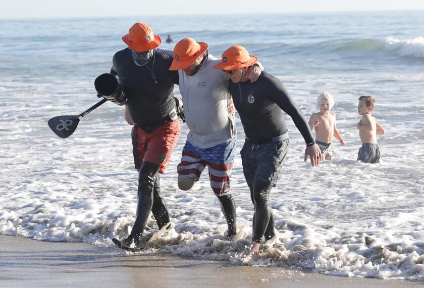 Kane Johnson, veteran Jake Green and Dane Morrissey on the beach during Operation Open Water