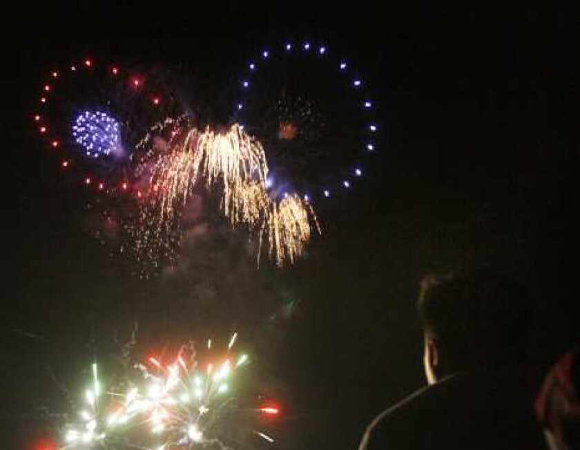 People watch the July 4 fireworks show at La Crescenta Elementary School