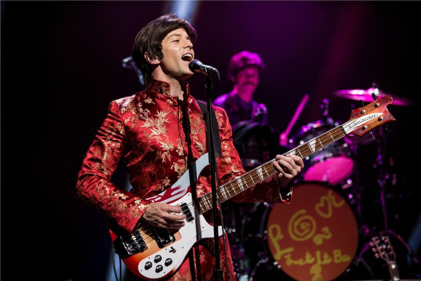 """James Fox, as Paul McCartney, performing """"Magical Mystery Tour"""" in the rock musical """"Let It Be"""" at the St. James Theater in New York."""