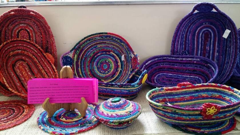 Handmade baskets line a shelf at Grossmont Nutrition.