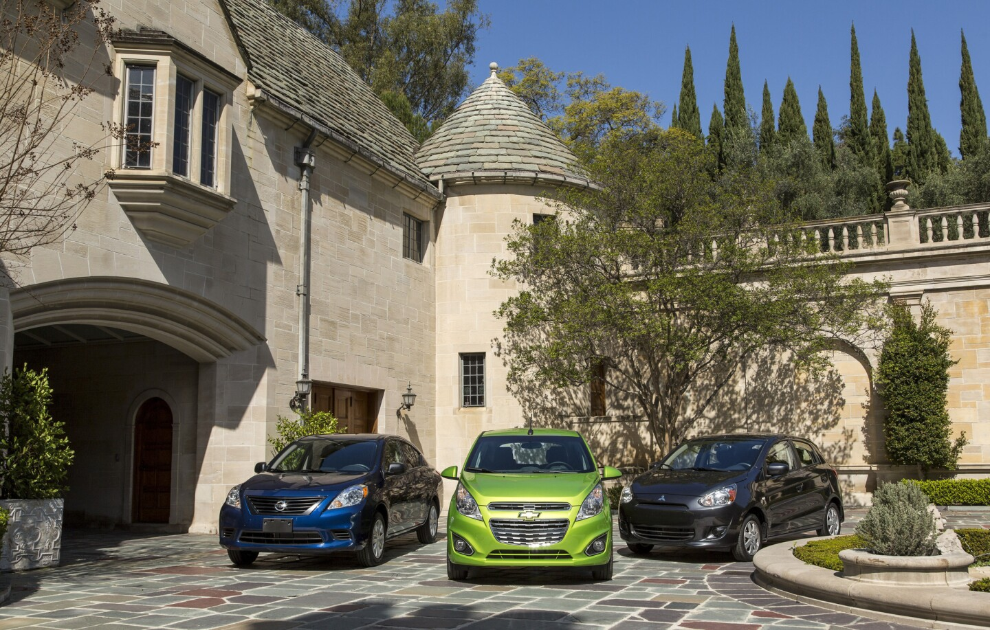 The Nissan Versa, left, Chevy Spark and Mitsubishi Mirage at the Greystone Mansion in Beverly Hills. These are the cars for people who want nothing more than the cheapest possible transportation, who view driving as a chore.
