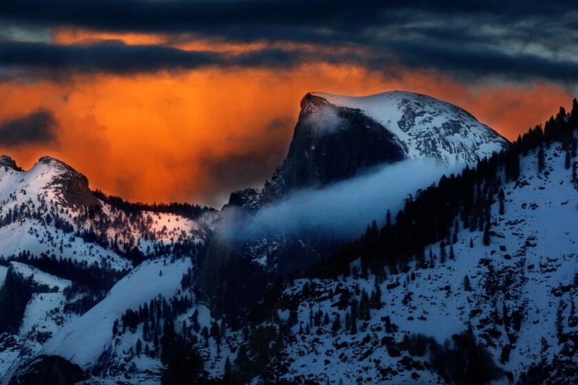 """""""Too many gray rocks."""" Yep, that's what one person thinks of Yosemite National Park, where the skies behind majestic Half Dome take on an eerie glow as the sun sets on another beautiful winter's day."""