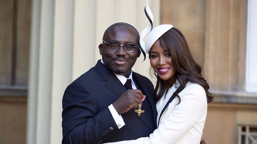 Edward Enninful after receiving his Officer of the Order of the British Empire (OBE) and Naomi Campbell during the investiture ceremony at Buckingham Palace in London on Oct. 27, 2016.