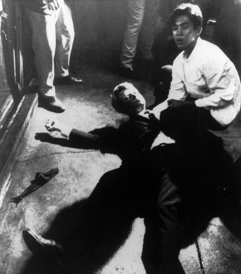Sen. Robert F. Kennedy awaits medical assistance as he lies on the floor of the Ambassador hotel in Los Angeles moments after he was shot.