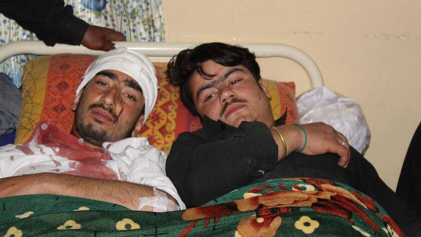 Pakistani blast victims are treated at a hospital in Parachinar, the capital of the Kurram tribal di
