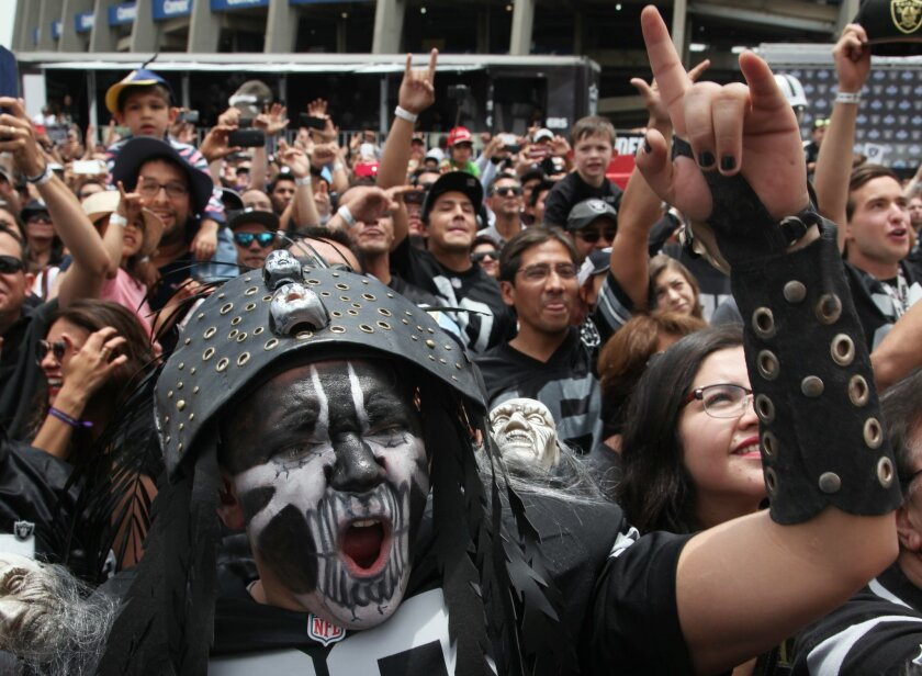 Oakland Raiders fans cheer during an event with the team's players  on Nov. 21, 2016. (AP Photo/Marco Ugarte)
