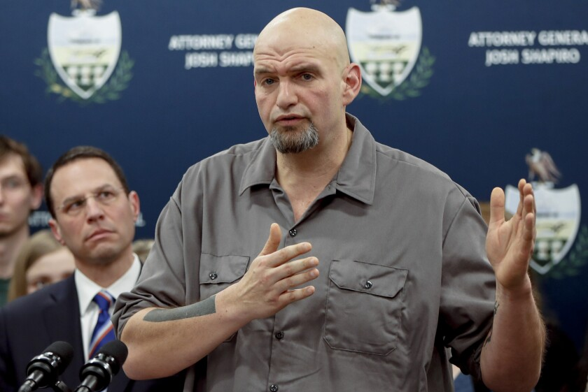 FILE - In this Feb. 7, 2019, file photo, Pennsylvania Lt. Gov. John Fetterman, right, speaks during a news conference in Pittsburgh. Democrats see one of their best chances to pick up a Senate seat in a Senate during next year's midterms in Pennsylvania.(AP Photo/Keith Srakocic, File)
