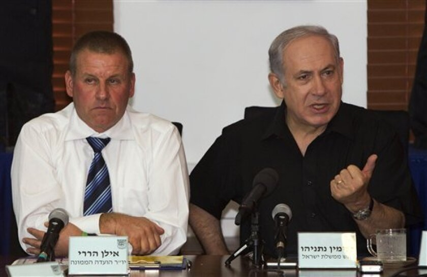 Israeli Prime Minister Benjamin Netanyahu, right, and Israeli official Ilan Harari attend a meeting during Netanyahu visit in the Israeli town of Lod, Thursday, Oct. 7, 2010. Netanyahu has agreed to hold a vote on a controversial citizenship bill in what appears to be a move aimed at garnering support for an extension of a West Bank settlement slowdown. (AP Photos/Jack Guez, Pool)