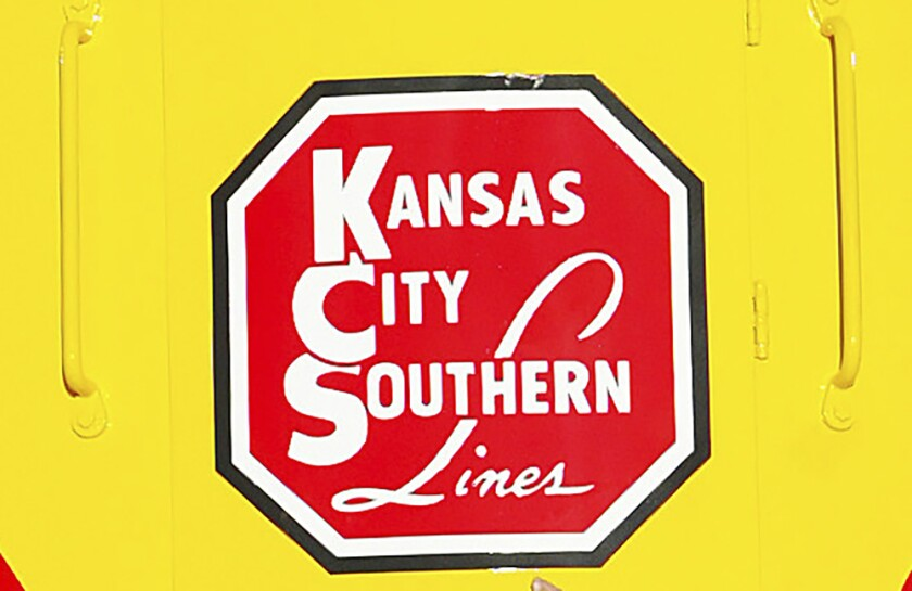 FILE - In this Nov. 5, 2004 file photo, the logo of Kansas City Southern is down on a restored 1954 Kansas City Southern passenger locomotive at Union Station in Kansas City, Mo. A bidding war is breaking out for Kansas City Southern, with Canadian National Railway making a $33.7 billion cash-and-stock offer for the railway. The bid trumps a $25 billion cash-and-stock proposal made by Canadian Pacific last month. Shares of Kansas City Southern jumped more than 18% in Tuesday, April 20, 2021 premarket trading.(Norman Ng/The Kansas City Star via AP)