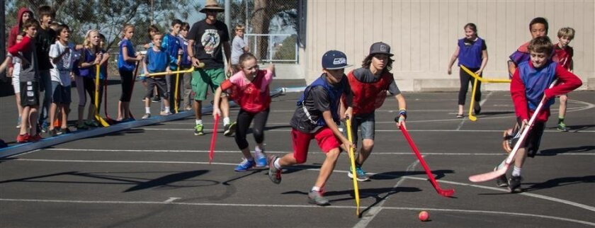 """The hockey """"field"""" at Del Mar Heights school is lined with rain gutters to keep the """"puck"""" from escaping."""