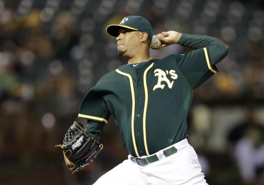 Oakland Athletics pitcher Felix Doubront works against the Texas Rangers during the first inning of a baseball game Wednesday, Sept. 23, 2015, in Oakland, Calif. (AP Photo/Ben Margot)