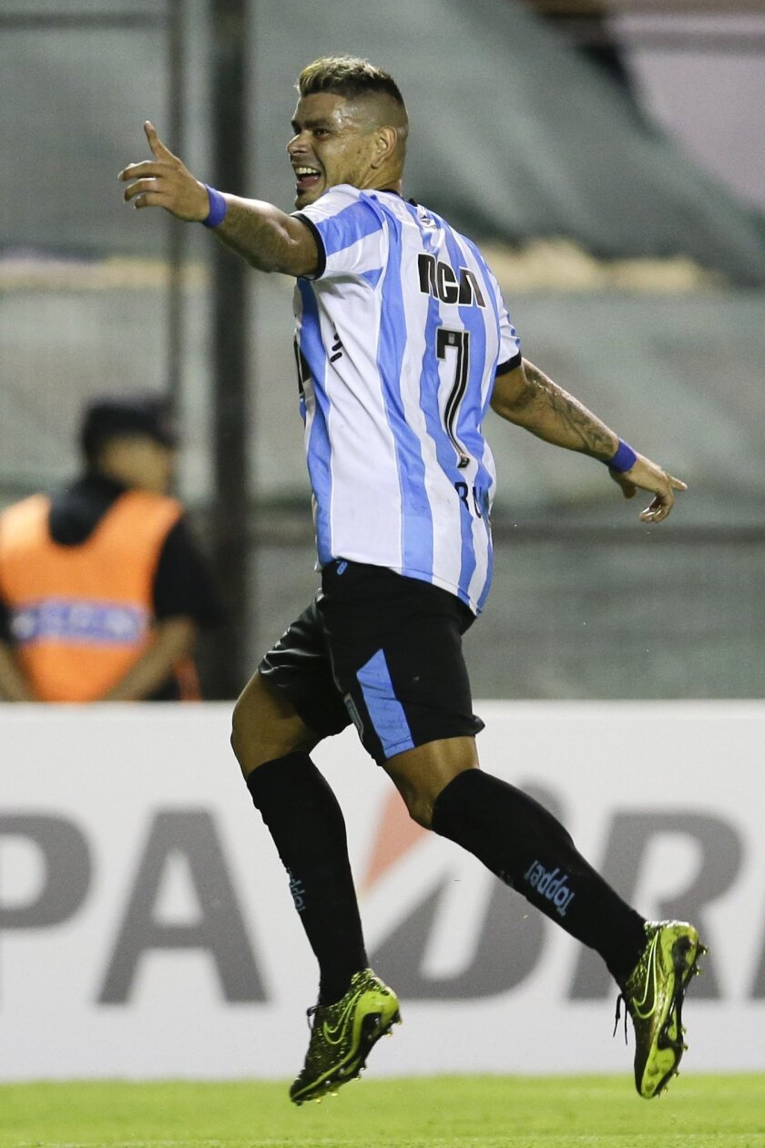 Argentina's Racing Gustavo Bou celebrates after scoring against Mexico's Puebla during a Copa Libertadores soccer match in Buenos Aires, Argentina, Wednesday, Feb. 10, 2016.  (AP Photo/Victor R. Caivano)
