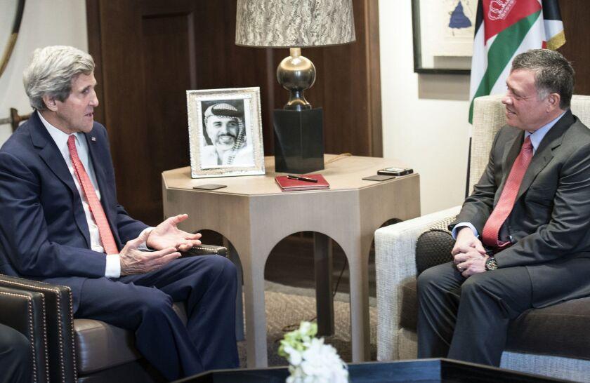Secretary of State John Kerry, Left, speaks with Jordan's King Abdullah II before a meeting at Al-Hummar Palace in Amman.