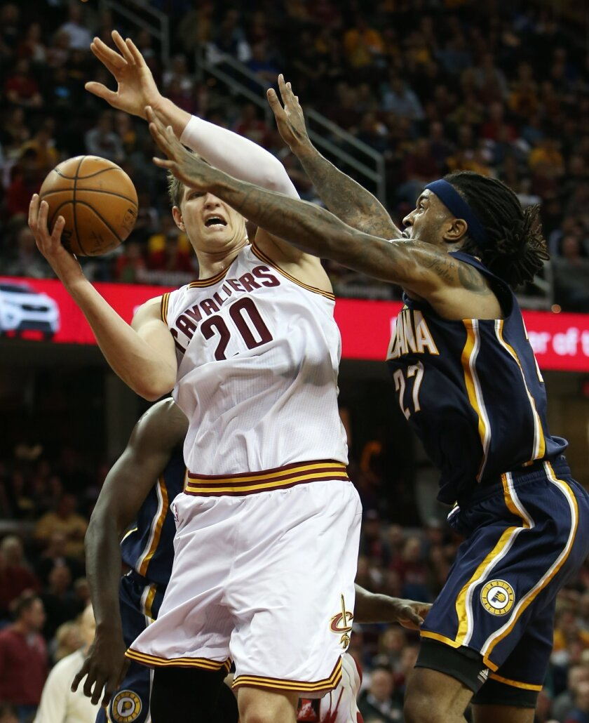 Cleveland Cavaliers center Timofey Mozgov (20) looks to pass around Indiana Pacers center Jordan Hill (27) during the second half of an NBA basketball game, Sunday, Nov. 8, 2015, in Cleveland. The Cavaliers won 101-97. (AP Photo/Ron Schwane)