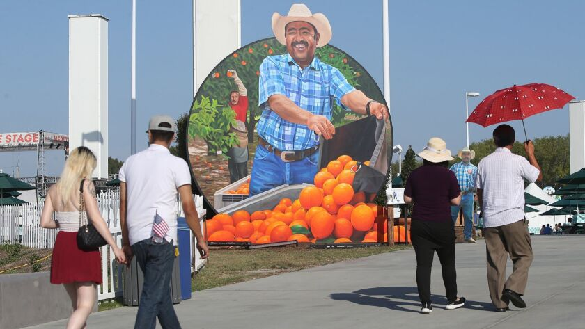 The face of Neff Farm manager Martin Almanza greets fair-goers as part of the Bounty of the County s