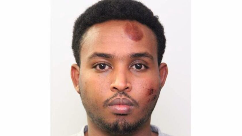 This undated photo provided by the Edmonton Police shows Abdulahi Hasan Sharif, who was arrested following attacks on an Edmonton police officer and several pedestrians.