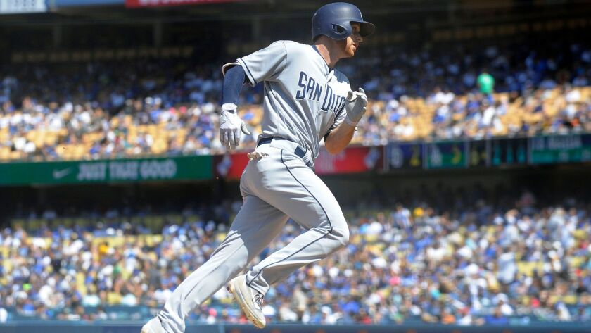 Padres third baseman Cory Spangenberg (15) rounds the bases after hitting a two run home run in the sixth inning against the Los Angeles Dodgers at Dodger Stadium on Aug. 13, 2017.