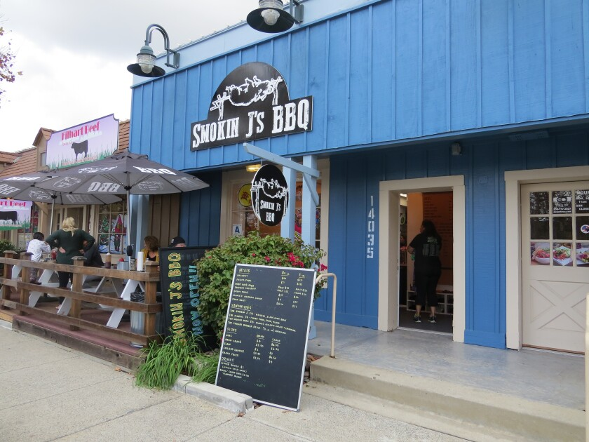 The exterior of Smokin J's BBQ, which opened Nov. 29 in the Old Poway Village Shopping Center.