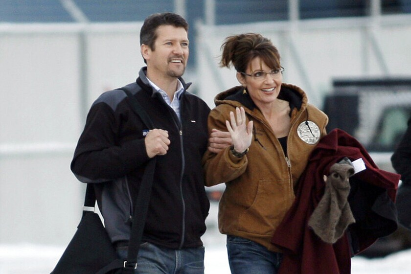 Sarah and Todd Palin walk to a plane at Ted Stevens Anchorage International Airport in 2008, the year Alaska's governor became the Republican vice presidential nominee.