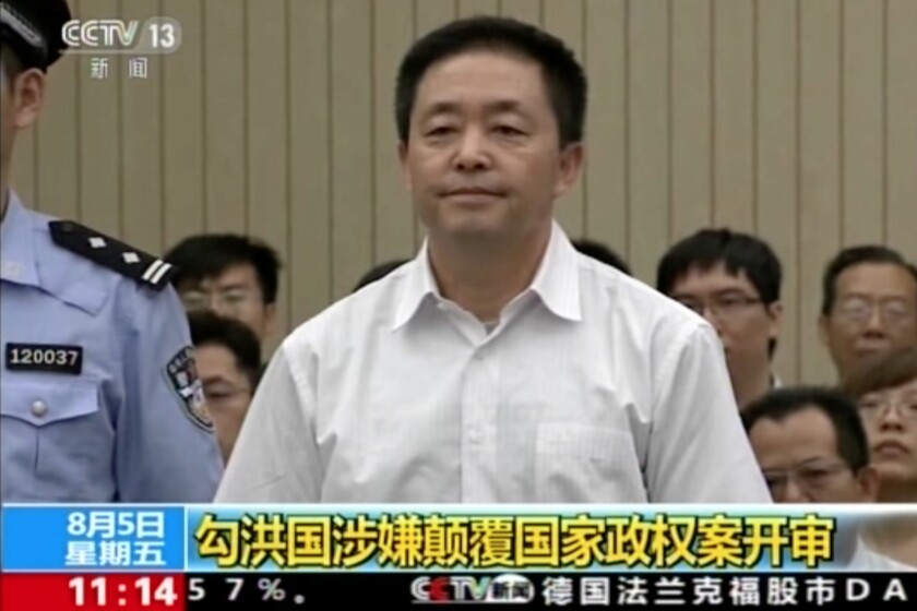 In this image taken from video, human rights activist Gou Hongguo stands for his trial at the Tianjin No. 2 Intermediate People's Court in northern China's Tianjin Municipality on Aug. 5, 2016.