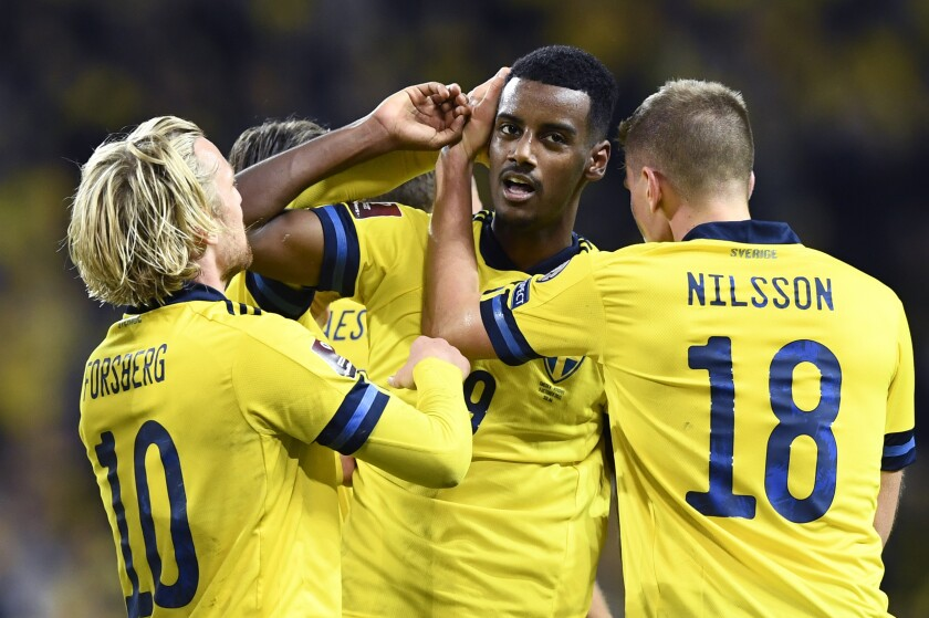 Sweden's Alexander Isak celebrates his goal 1-0 with teammates during the World Cup 2022 group B qualifying soccer match between Sweden and Kosovo at Friends Arena in Stockholm, Sweden, Saturday Oct. 09, 2021. (Erik Simander/TT via AP)