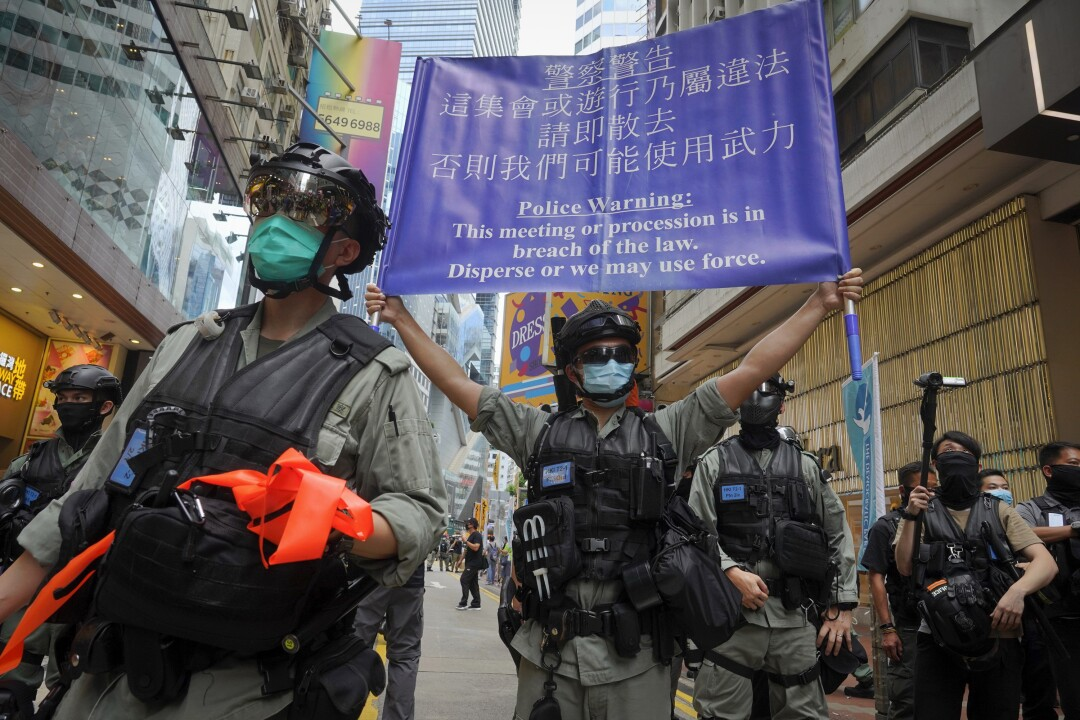Police display a banner warning protesters in Causeway Bay in Hong Kong.