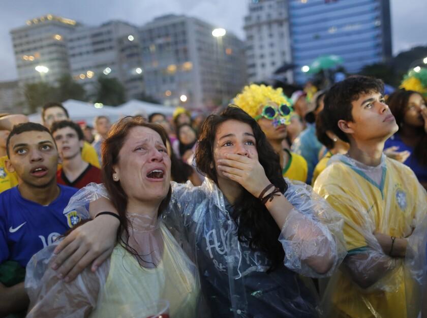 Brazilian soccer fans can't hide their shock at the FIFA Fan Fest area in Rio de Janeiro.