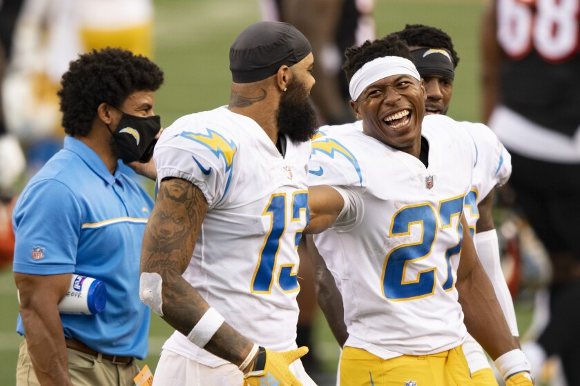 Chargers running back Josh Kelley (27) and wide receiver Keenan Allen (13) celebrate their team's win
