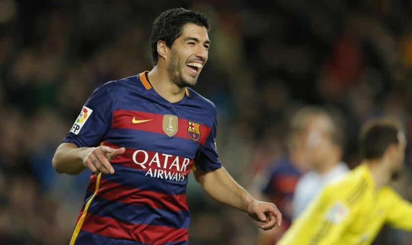 FC Barcelona's Luis Suarez reacts after scoring against Celta Vigo during a Spanish La Liga soccer match at the Camp Nou stadium in Barcelona, Spain, Sunday, Feb. 14, 2016. (AP Photo/Manu Fernandez)