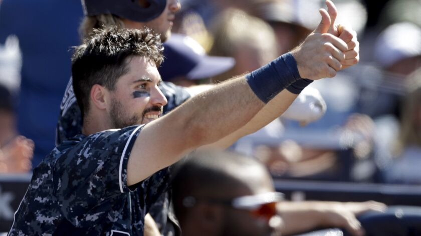 Padres catcher Austin Hedges reacts during the eighth inning of a baseball game against the Philadelphia Phillies Sunday, Aug. 12, 2018, in San Diego.