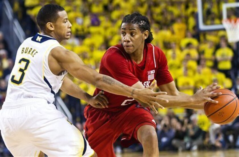 Michigan guard Trey Burke (3) defends Nebraska guard David Rivers (2) in the first half of an NCAA college basketball game, Wednesday, Jan. 9, 2013, at Crisler Center in Ann Arbor, Mich. (AP Photo/Tony Ding)