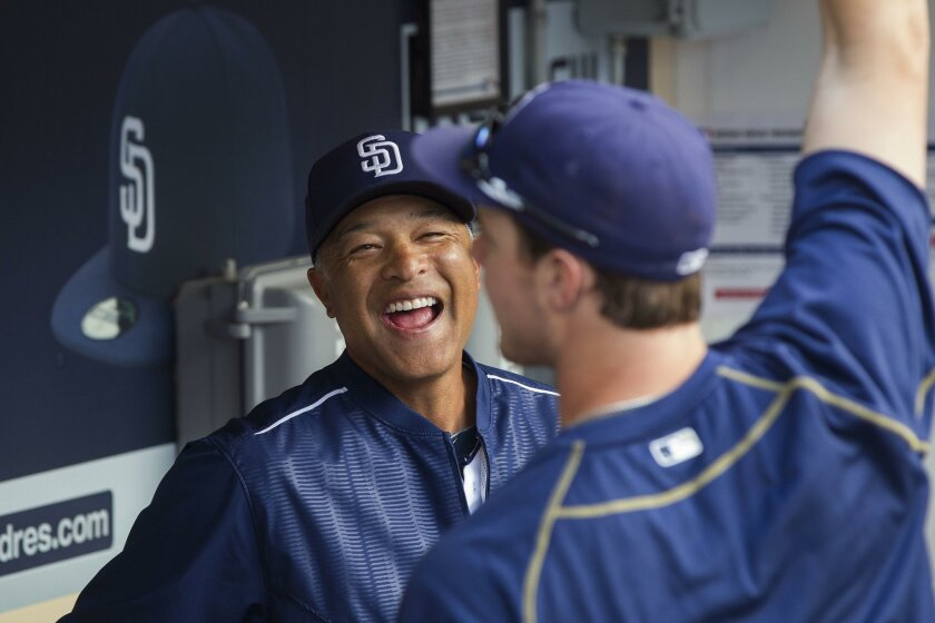 Shown sharing a laugh in the Padres dugout with Wil Myers in June 2015, Dave Roberts headlines this year's class of San Diego Hall of Fame inductees. The Rancho Buena Vista High product will then begin his first spring training as the Dodgers manager.
